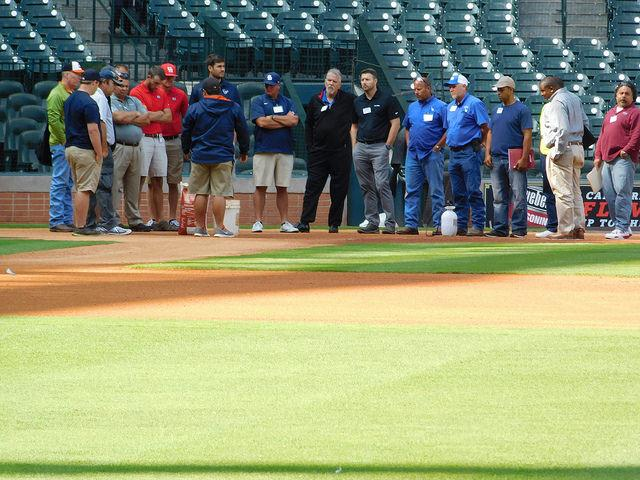 Members of the Houston Astros grounds crew discuss field maintenance processes and techniques with members of the Texas Sports Turf Managers Association.